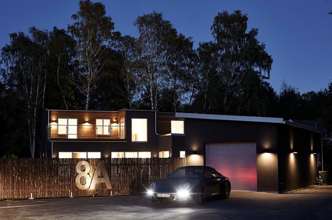 Swedish Private House Contrasting Design. Night sight of the home exterior