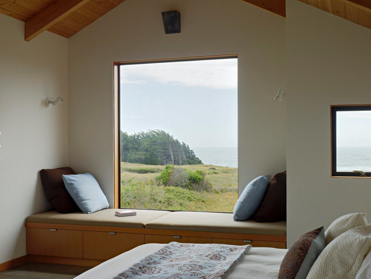 Panoramic Windows Design and Using in Modern Homes Ideas. tight bedroom with wooden beams, large window and the austere designed bed
