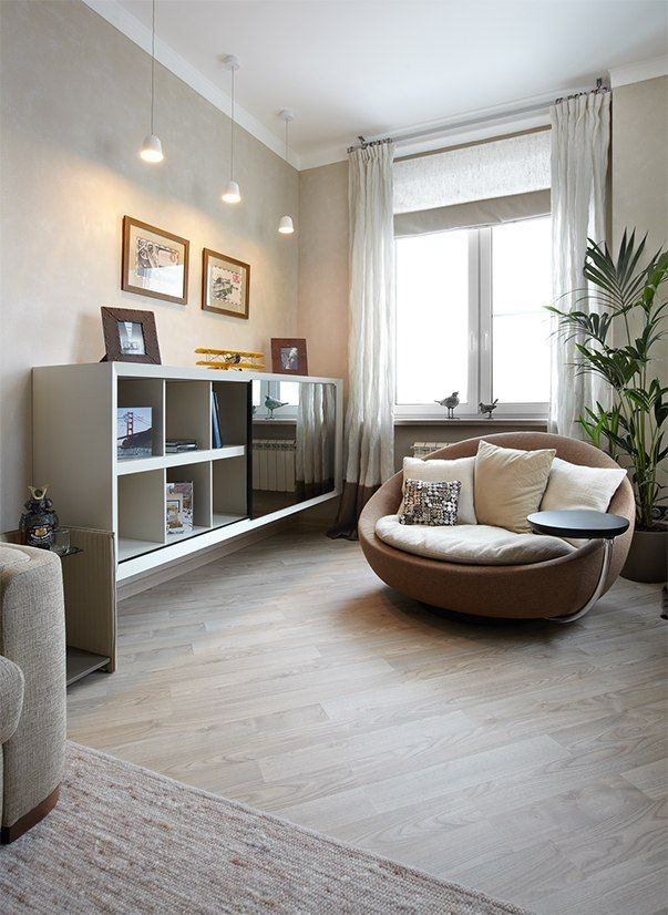 Small Design Ideas for Oblong Rooms. Nice neutral light interior of the living room with round couch