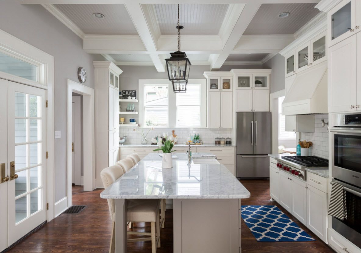 Color Combining for the Exquisite Interior Design. Marble polished countertop is win-win solution for the white trimmed kitchen