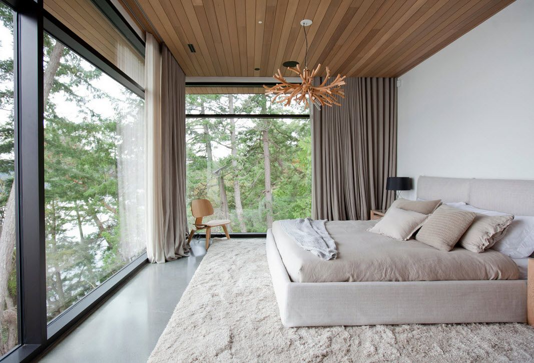 Ceiling Designs 2016: Full Review of the New Trends. Large windows in the geometrically correct bedroom with unusual decoration