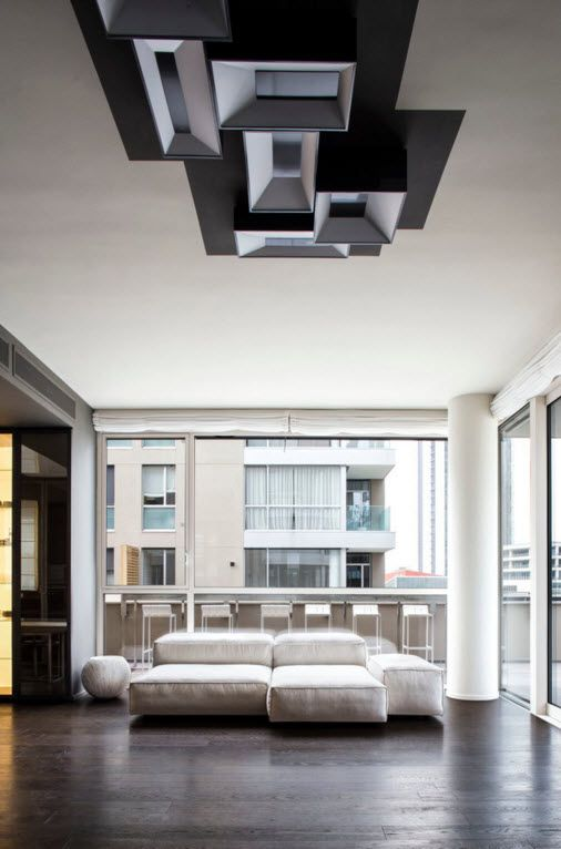 Hi-Tech Milan Apartment with Terrace Design Project. Full projection of the living room with interesting composition of the pendant lighting system and modular sofa near the panoramic window