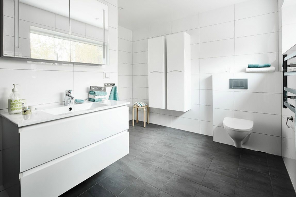 Swedish Private House Contrasting Design. White and gray combintaion in the bathroom