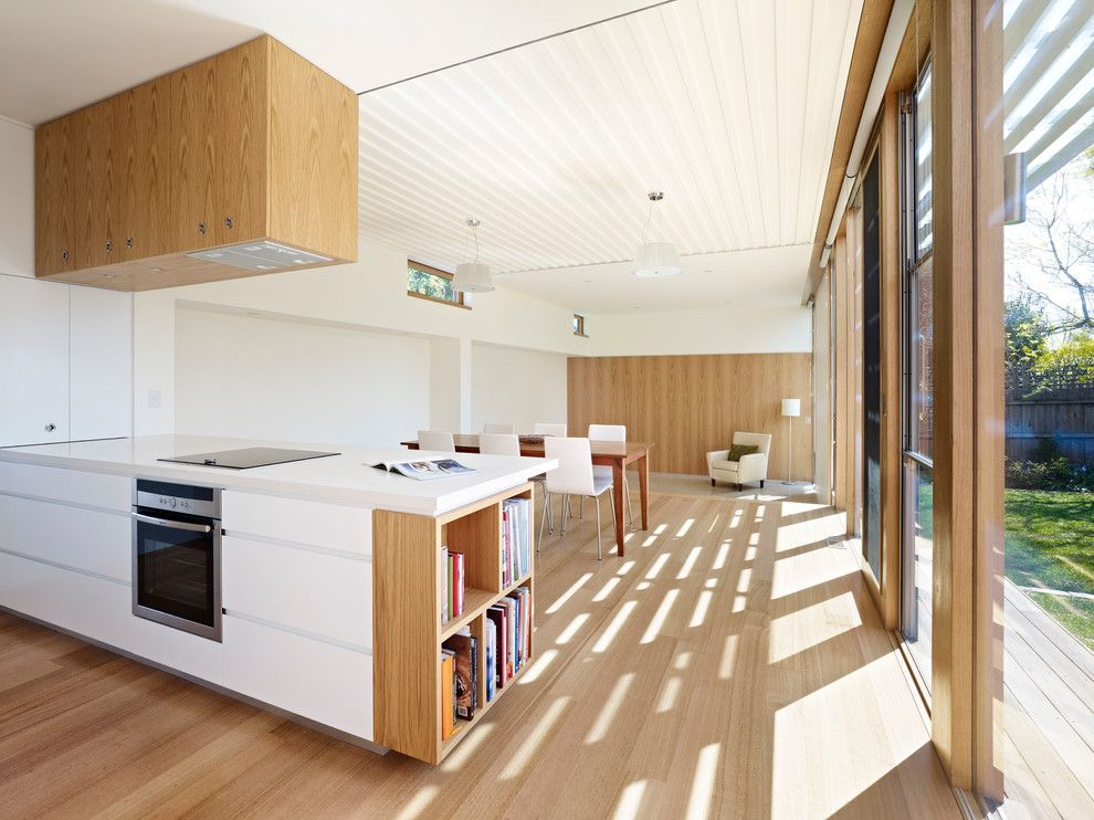 Ceiling Designs 2016: Full Review of the New Trends. Large kitchen and dining room full of natural light and natural wooden materials