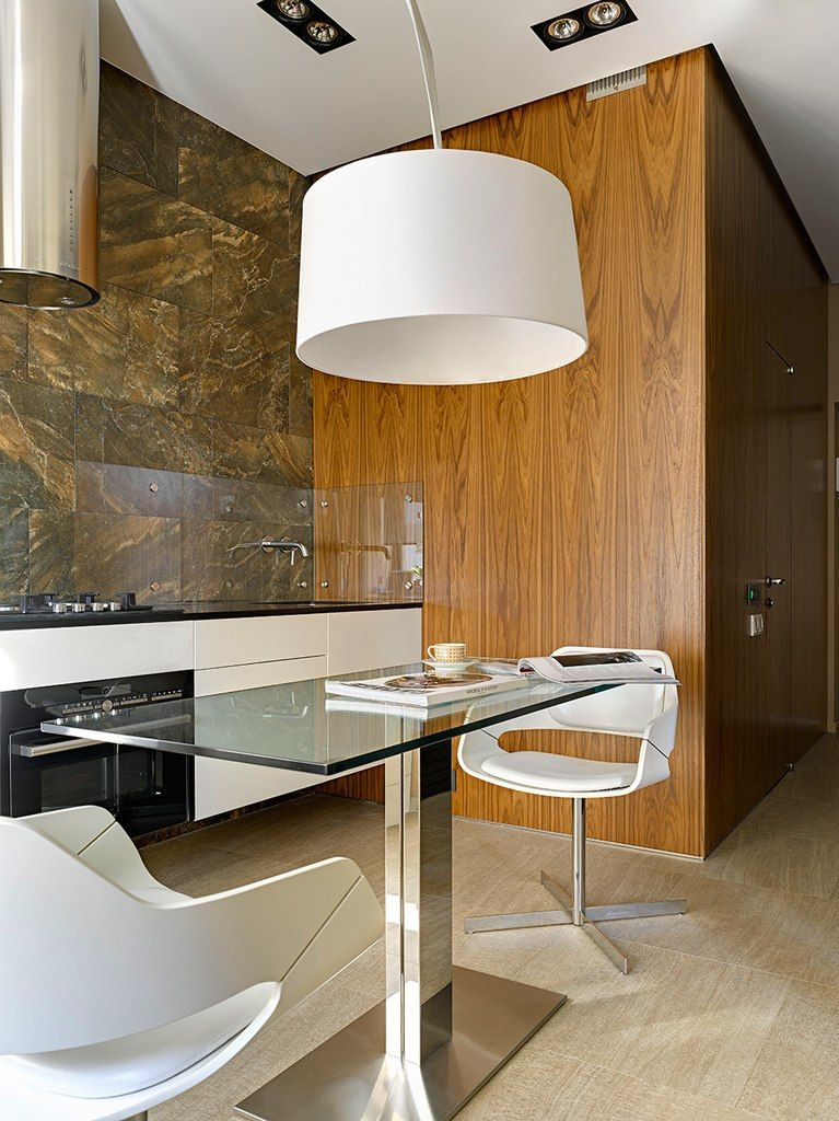 Small 38 Square Meters Moscow Apartment in Modern Style. Dining and resting zone is near the kitchen with a large semi-hanging lamp with big white lampshade creates a business atmosphere as in the home office