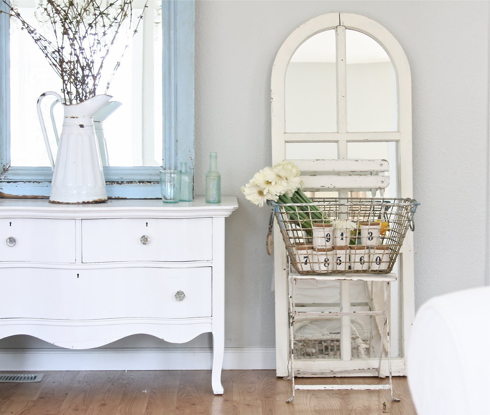 Shabby Chic Interior Design Style. Vintage styled table and the basket for the stuff and flowers
