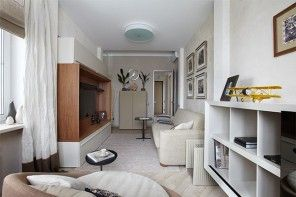 Small Design Ideas for Oblong Rooms. Real photo of the living room light trim design example full of paintings