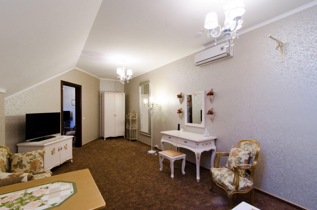 Formal designed bedroom with vintage furniture