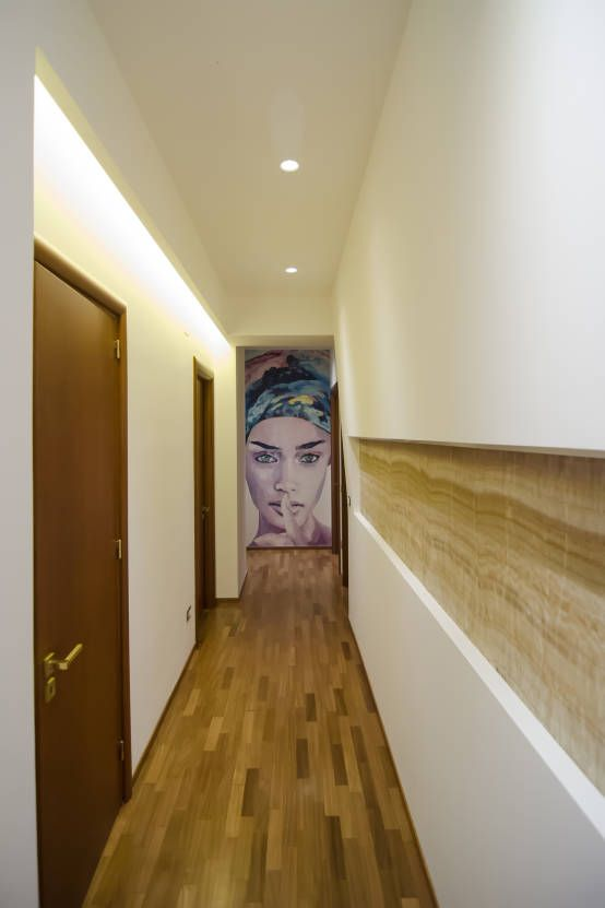 Modern Hallway Decoration Design Ideas. Laminate floor trimming and the accent wall image with minimalistic smooth ceiling and built-in fixtures are in trend