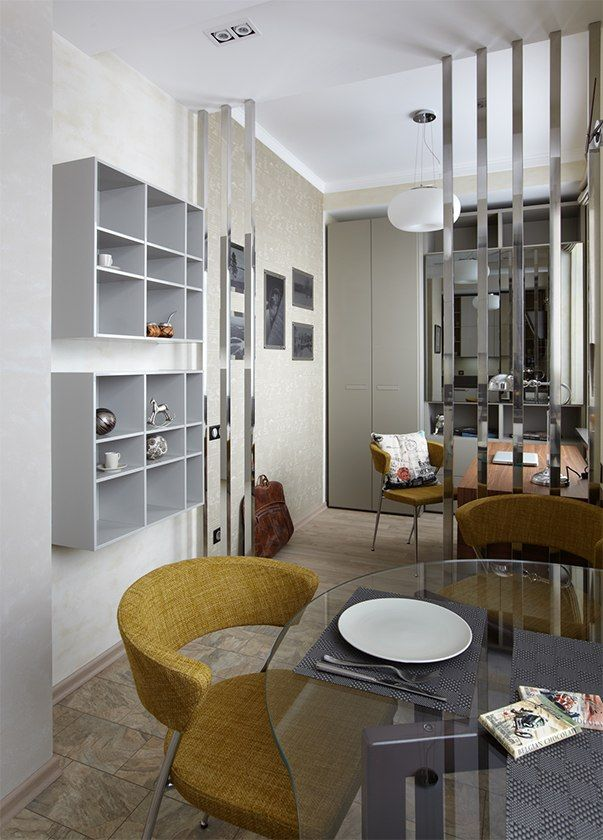 Small Design Ideas for Oblong Rooms. Living room with the glass table and upholstered bright furniture with lots of stuff creating the volume