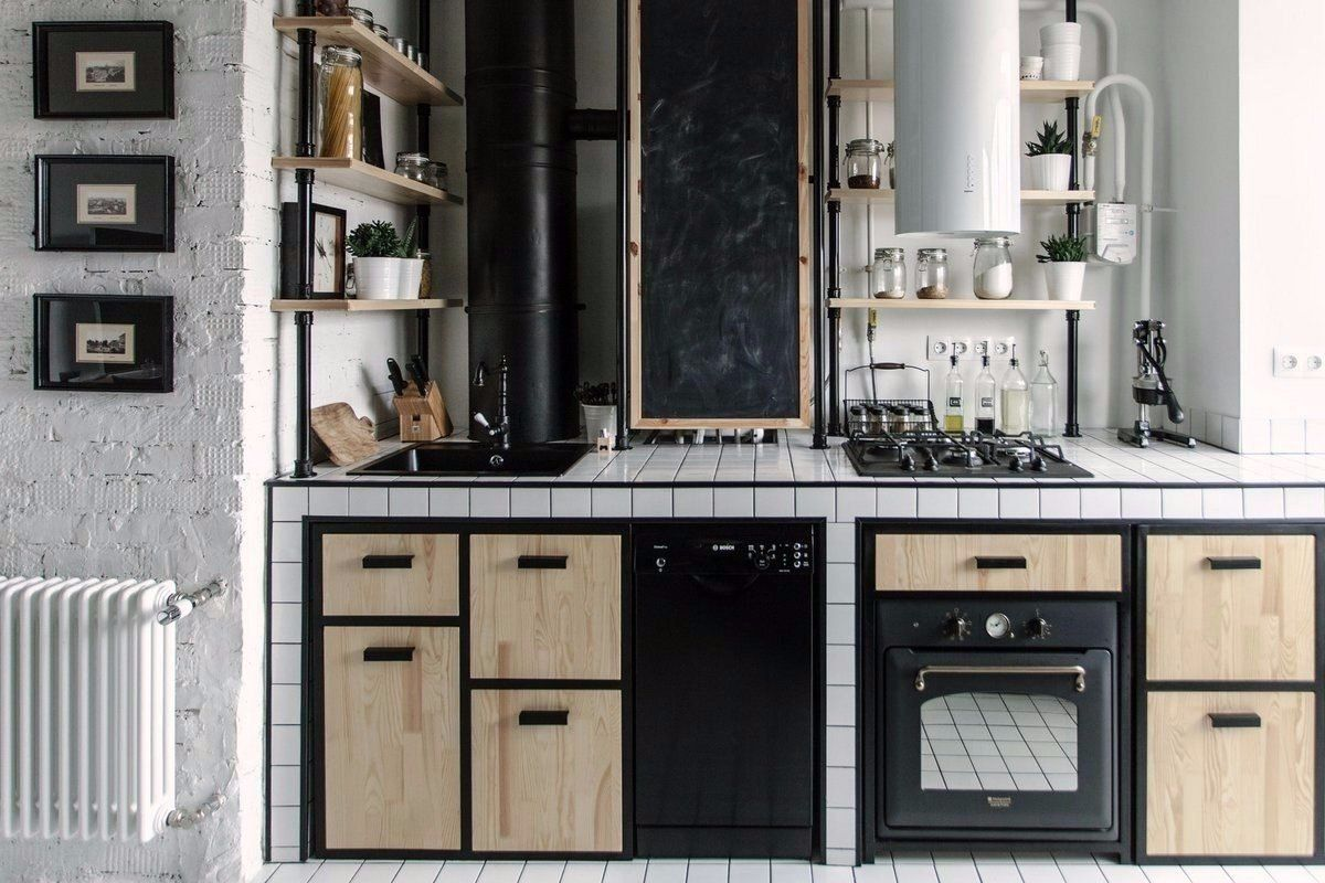 Cozy European Two-level Condo in Scandinavian Style Review. Convenient kitchen starts with comfortable and practical kitchen set. Here we have black and light wooden palette
