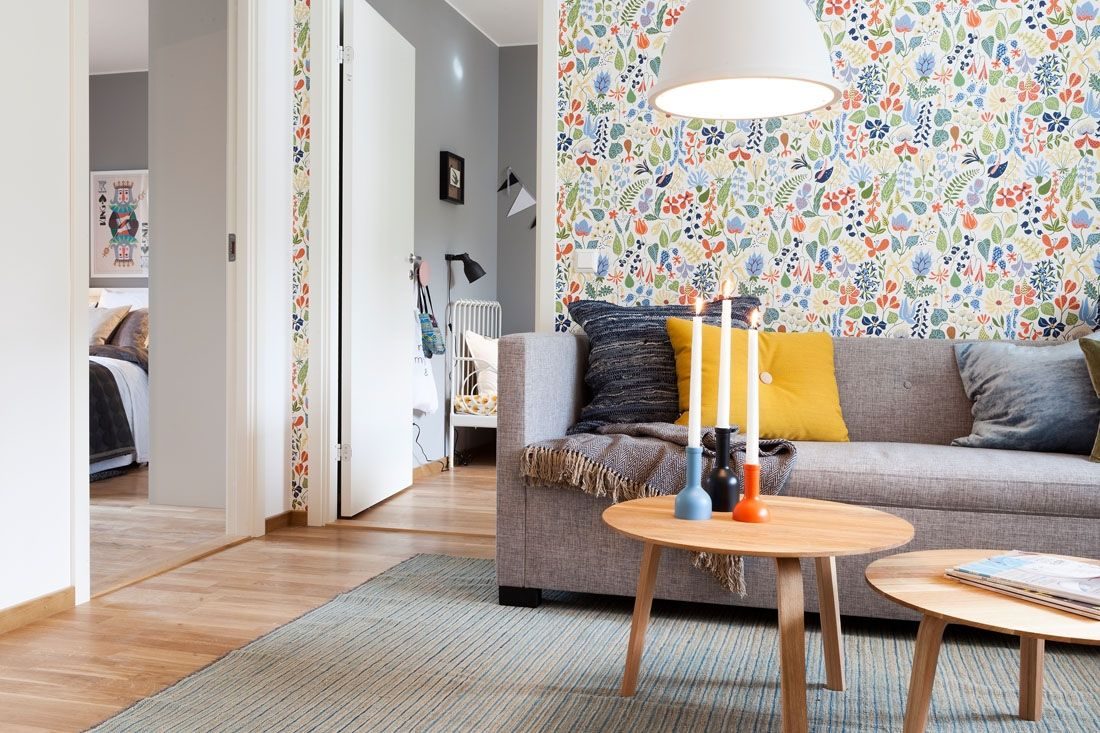 Two-Bedroom Apartment Scandinavian Style Design Review. Cozy relaxing atmosphere in the living room is achievde through the nice combination of bright color and natural materials