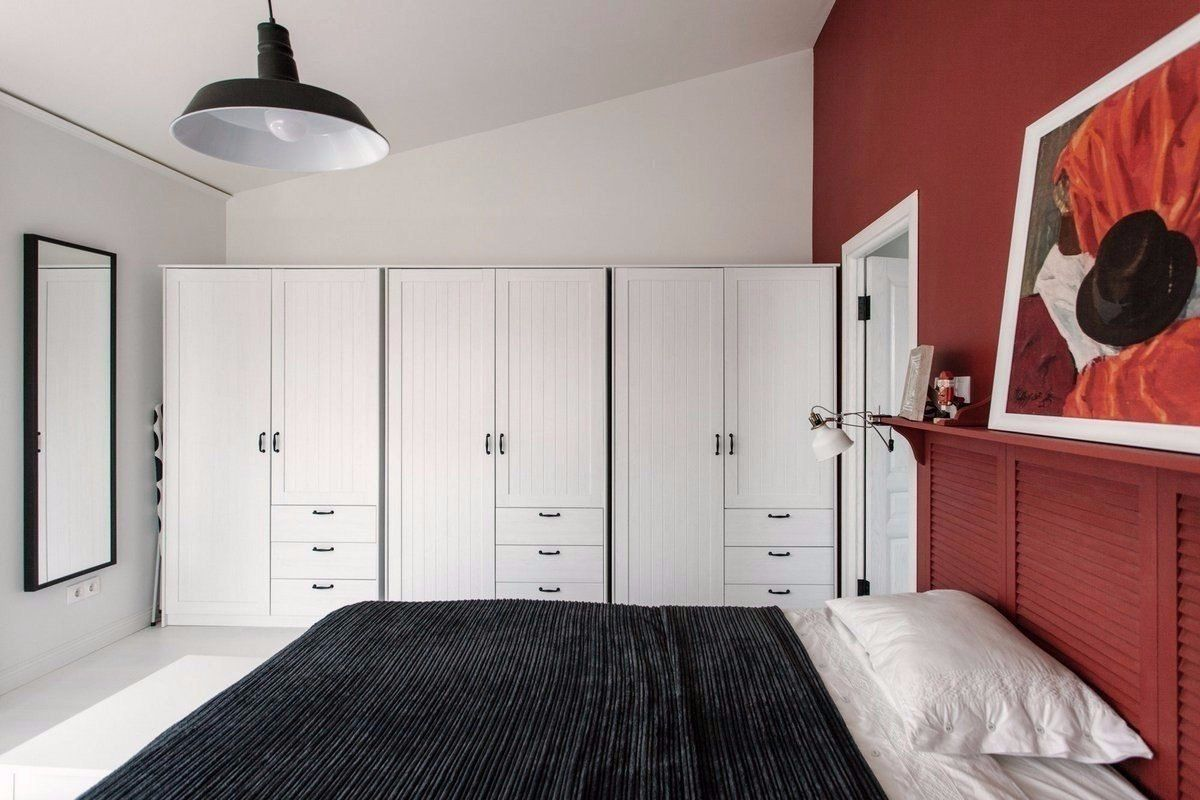 Cozy European Two-level Condo in Scandinavian Style Review. The cabinets in the bedroom remind of the lockers in the gym.