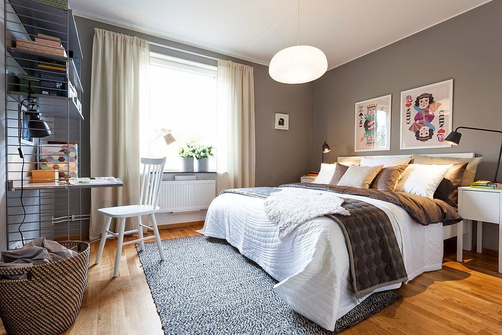 Two-Bedroom Apartment Scandinavian Style Design Review. Bedroom with royal bed, nice fur coverlet and the luscious colored laminate in the Stockholm, Sweden
