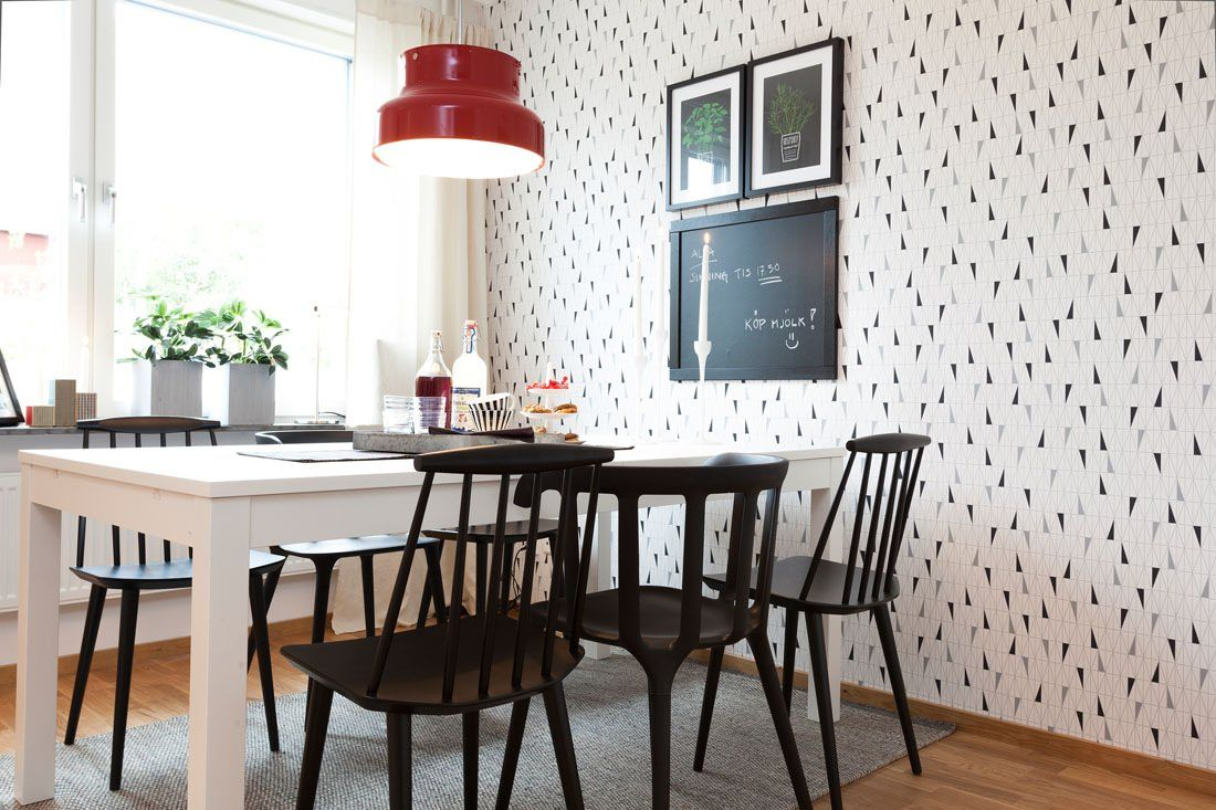Two-Bedroom Apartment Scandinavian Style Design Review. Dining zone in the kitchen with black chairs and white table