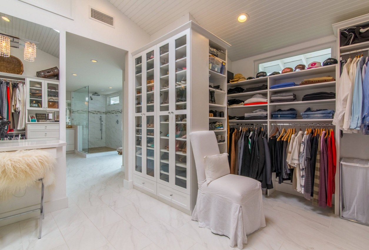 Custom Closet & Shelves & Wardrobe Original Design. Full of stuff wardrobe with glass doors closet and the white cover for the try-on chair