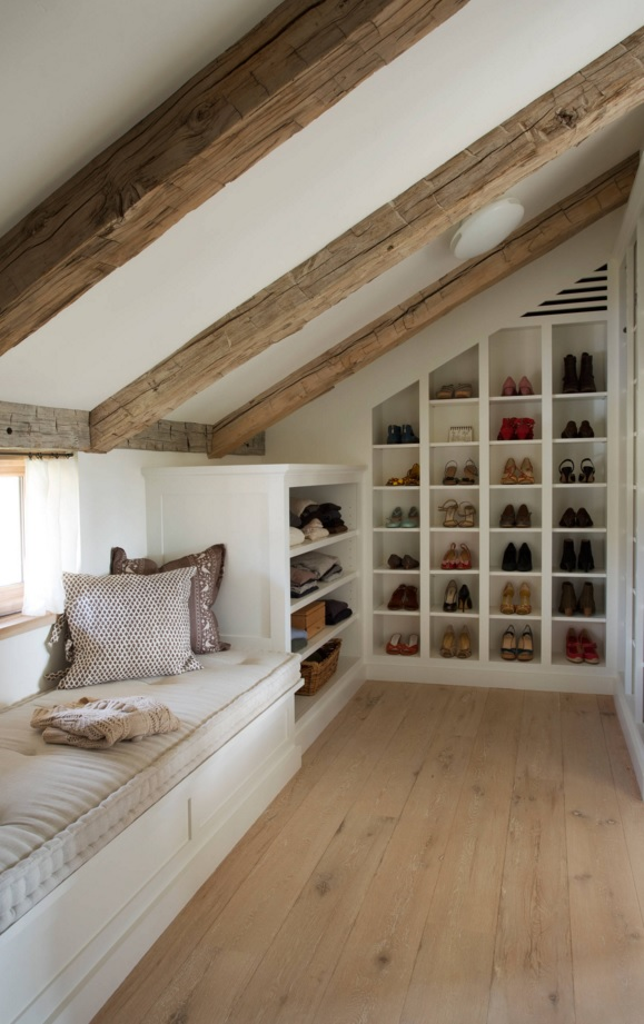 Custom Closet & Shelves & Wardrobe Original Design. Sloped ceiling with beams and a sleeper