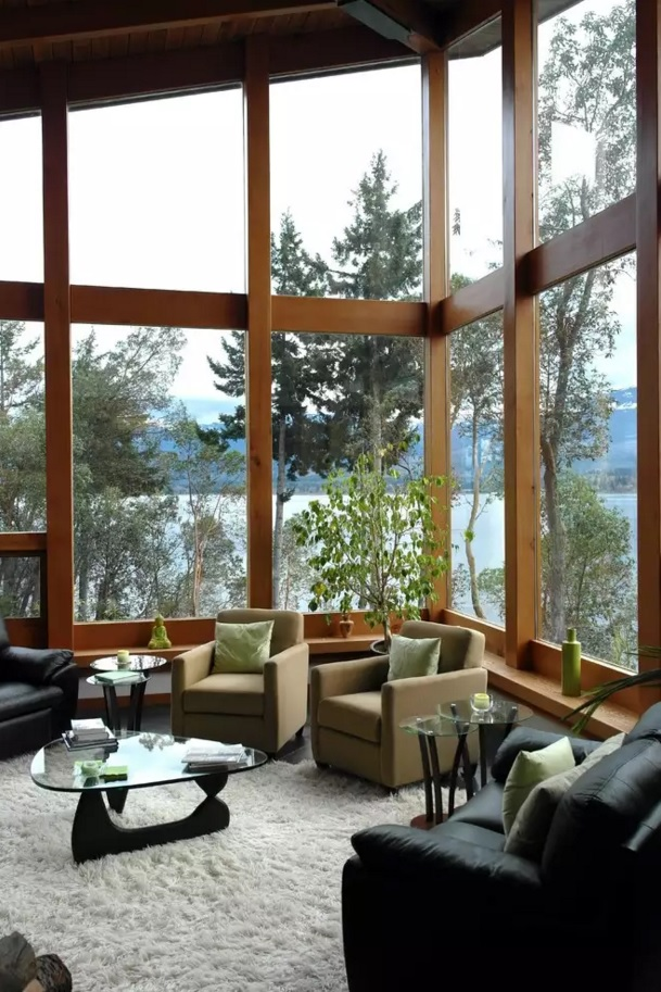 Unusual Trendy Living Room Interior Design Ideas. Forest private house with extremely high ceiling and large panoroamic windows, and with fresh furniture composition