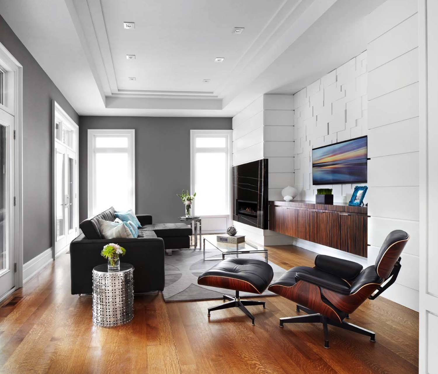 Black Furniture: Interior Design Photo Ideas. White interior with wooden trimming and the black touches of the couch and folding armchair