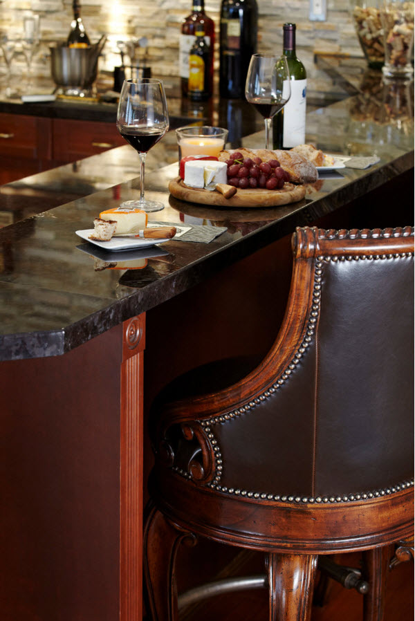 Modern Classics Private House Design Ideas. Close-up of the riveted leather stool