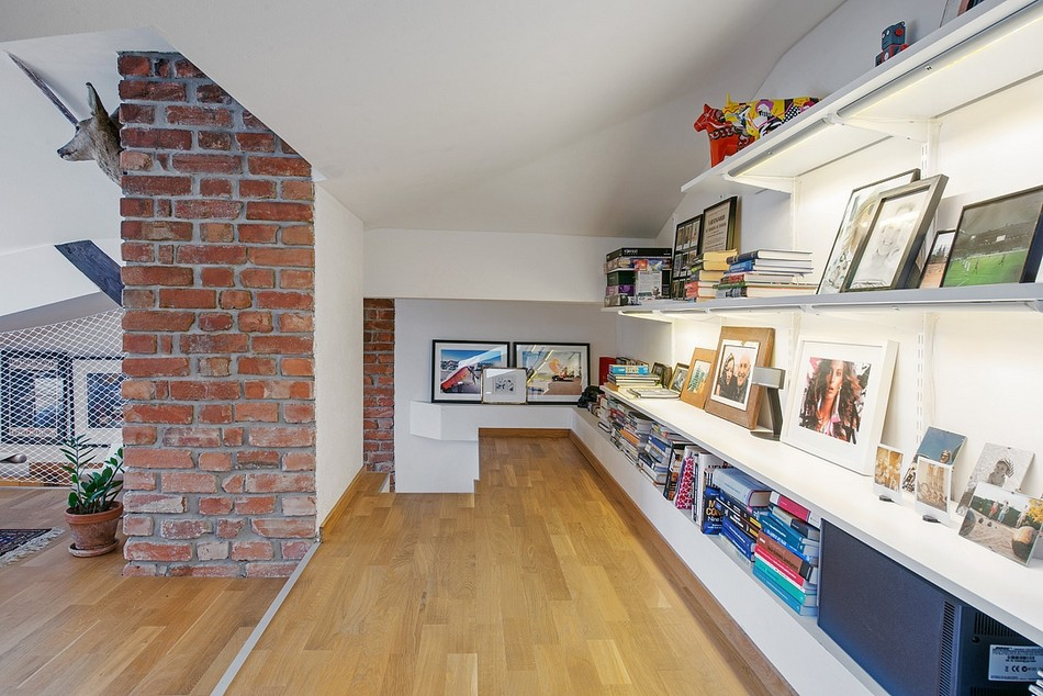 Scandinavian styled library with the brickwork and white walls