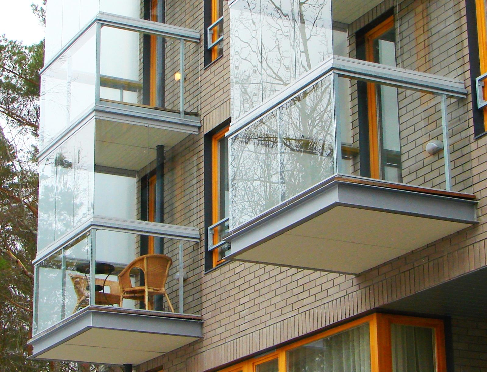 Modern Glazing for Balcony or Loggia. Frameless construction for exquisite exterioe design
