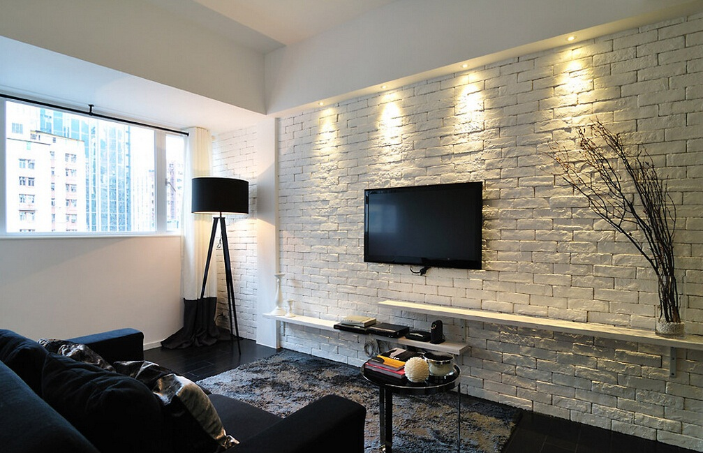 Apartments and Condos Design Projects 2016. Video area in the modern living roomwith brickwork plastered white accent wall with backlight