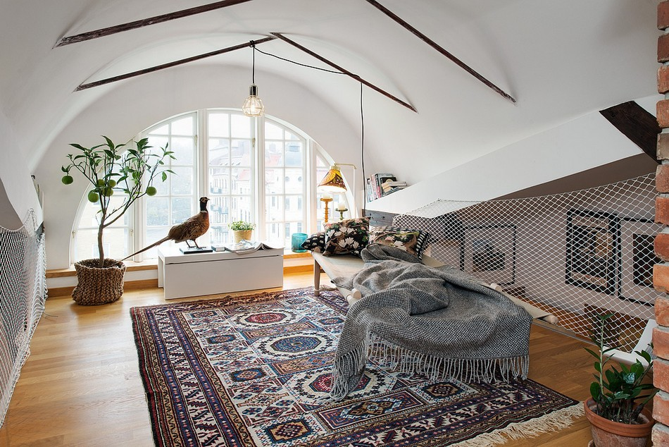 Unusual ceiling design with thin beams in the living room with large Eastern carpet and white trimmed walls