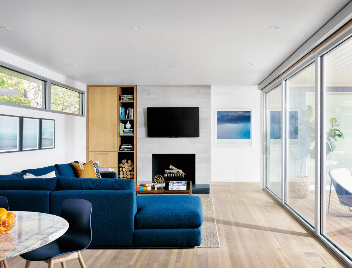 Storage Systems Variety for the Living Room. Open shelves and the wooden cabinet in the slightly asymmetrical room design with glass interior doors