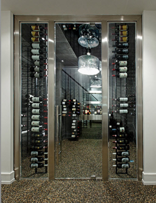 Exclusive Two-Storey House Design. wine cellar behind the glass