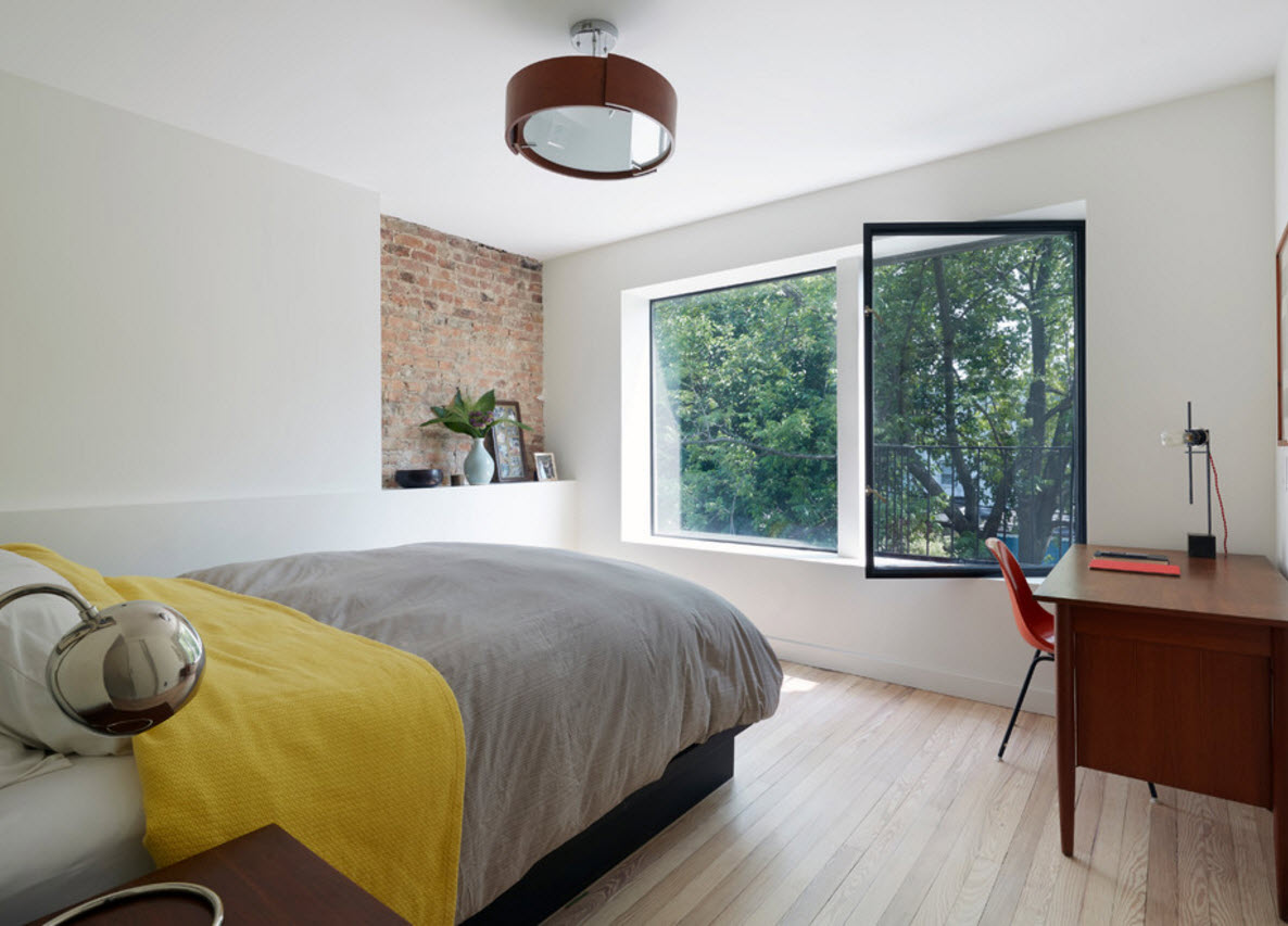 Nice fresh bedroom design with the yellow coverlet on the platform bed