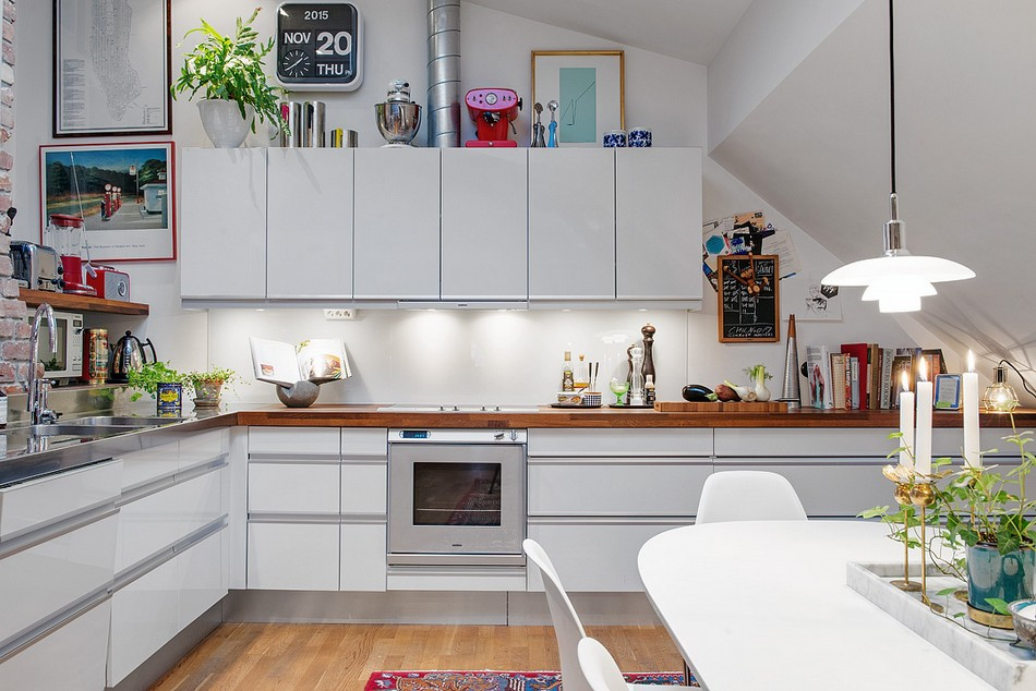 White surfaces of the low-key designed kitchen