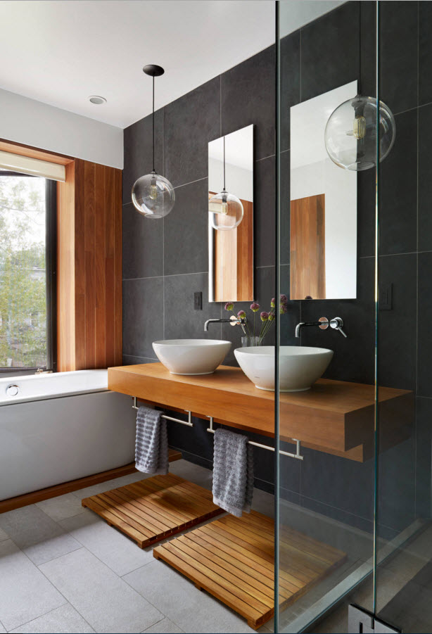 Two sinks in the gray trimmed bathroom