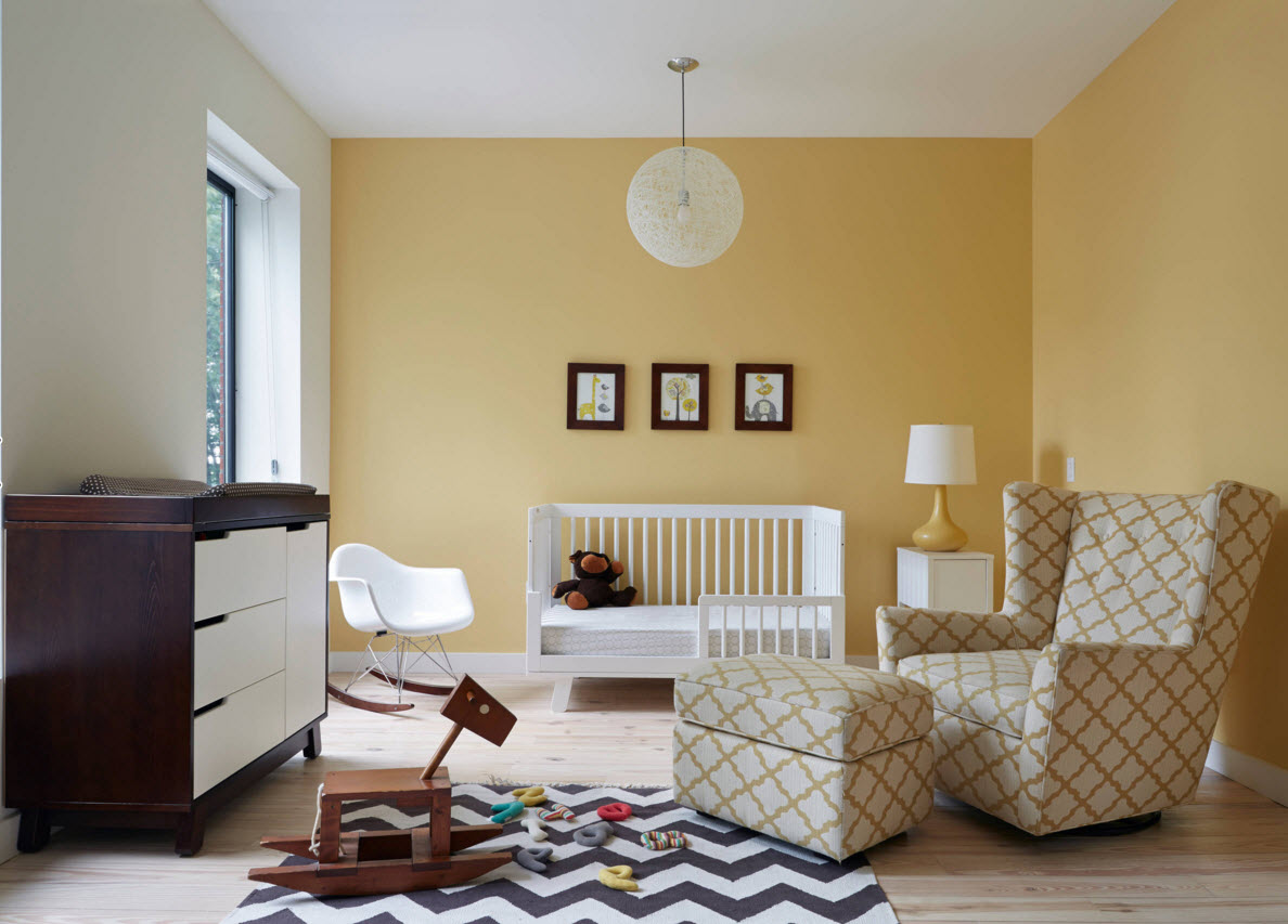 Peach color for the kid`s room with the pattern decorated furniture and rug
