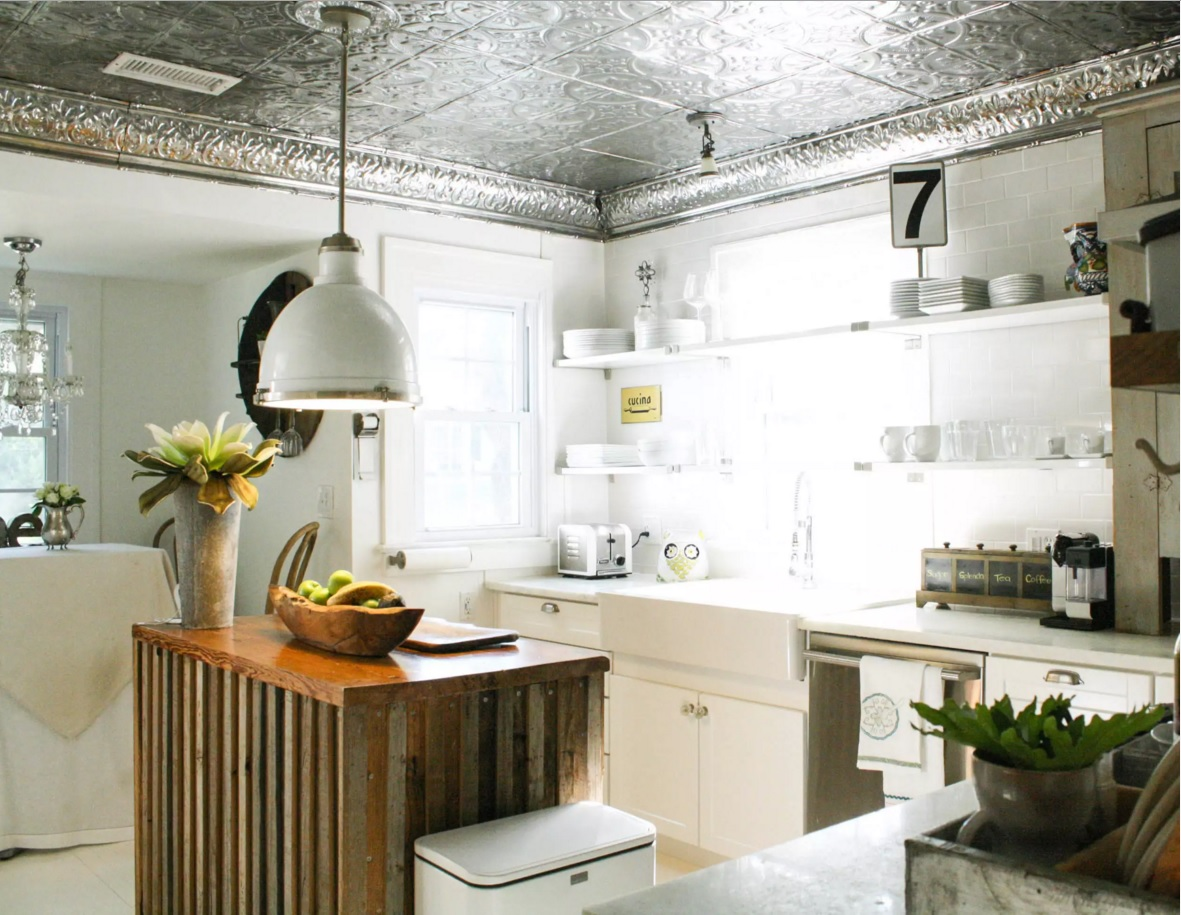 Choosing and Mounting the Ceiling Tiles. Shining silver plated tiles in the kitchen