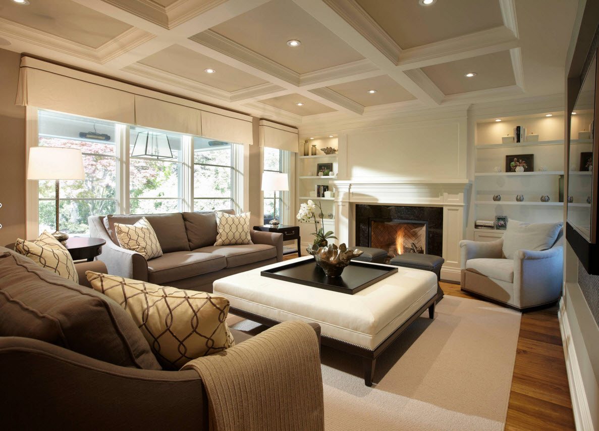 Storage Systems Variety for the Living Room. Creamy beige decoration with ceiling in decorative cells and the artificial fireplace next to the open shelves