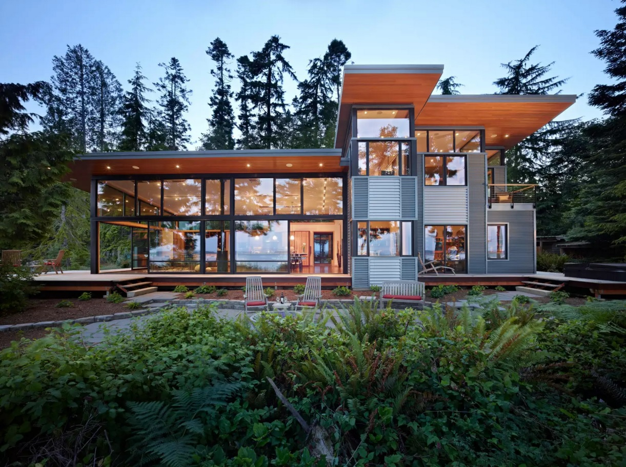 Original House Exterior Design Ideas. Nice construction of wood and glass with the artistic trim in the forest
