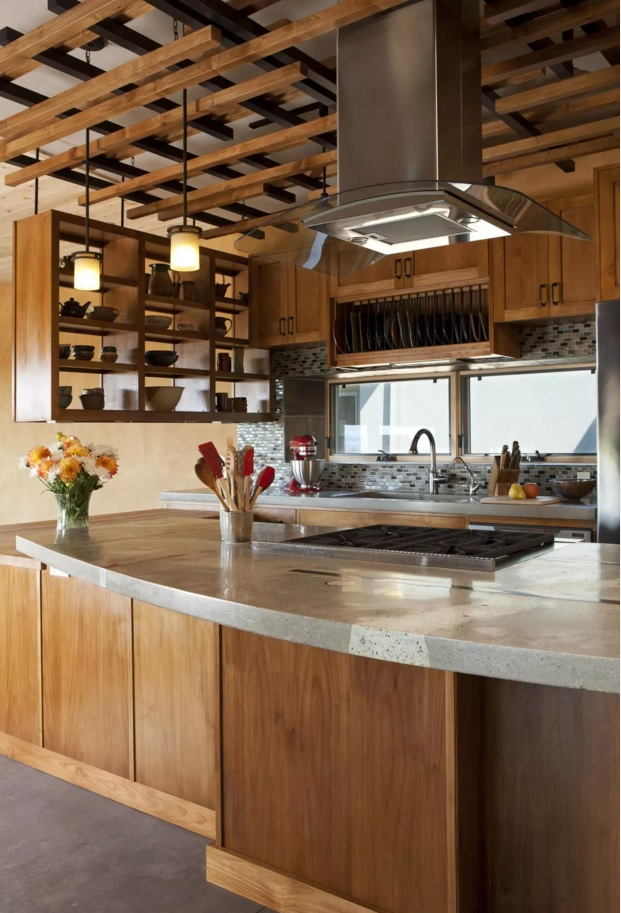 Unique design of the wooden construction under the ceiling of the kitchen zone