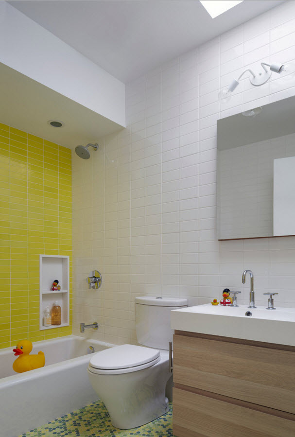 Yellow mosaic tiles in the bathroom for kids