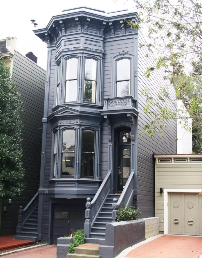 Original House Exterior Design Ideas. Old American naroow house in the big city stylized with black trimming