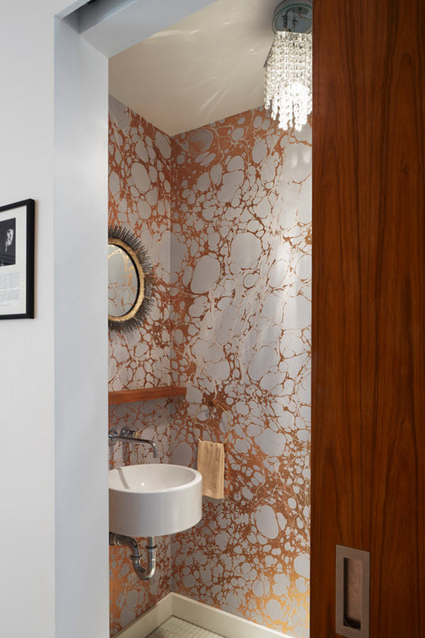 Another washbasin in the beathroom with unusual wallpaper