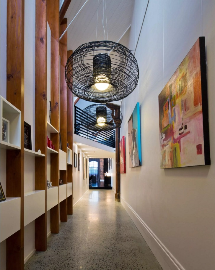 Top 20 Modern Unique Hallway Design Ideas. White trimmed library with paintings and original book shelves