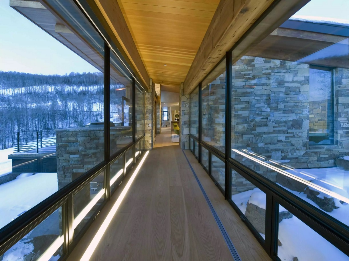 Top 20 Modern Unique Hallway Design Ideas. Rare concept of the glass passway between two parts of the big house