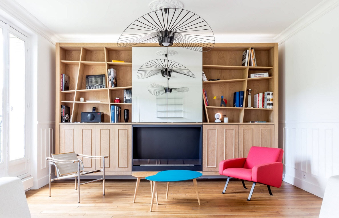 Storage Systems Variety for the Living Room. Unusual air fans grids and the colorful furniture completing the image