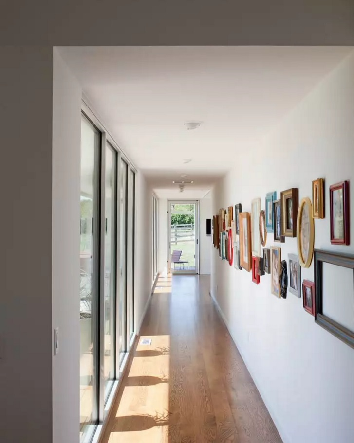 Top 20 Modern Unique Hallway Design Ideas. Effective multicolored frames for the numerous photos