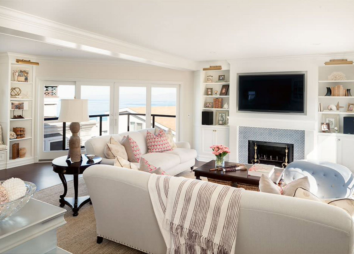 Storage Systems Variety for the Living Room. Nice airy private house` interior with the artificail fireplace in the TV-zone