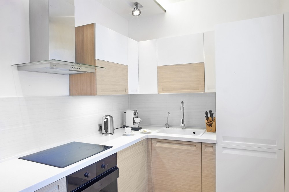 40 Square Meters Irregular Shape Apartment Photo Review. Kitchen with neutral color palette and minimalistic design of the furniture set