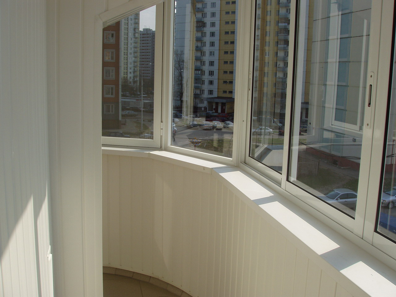 Modern Glazing for Balcony or Loggia. plastic frame for the window panes in the finished balcony