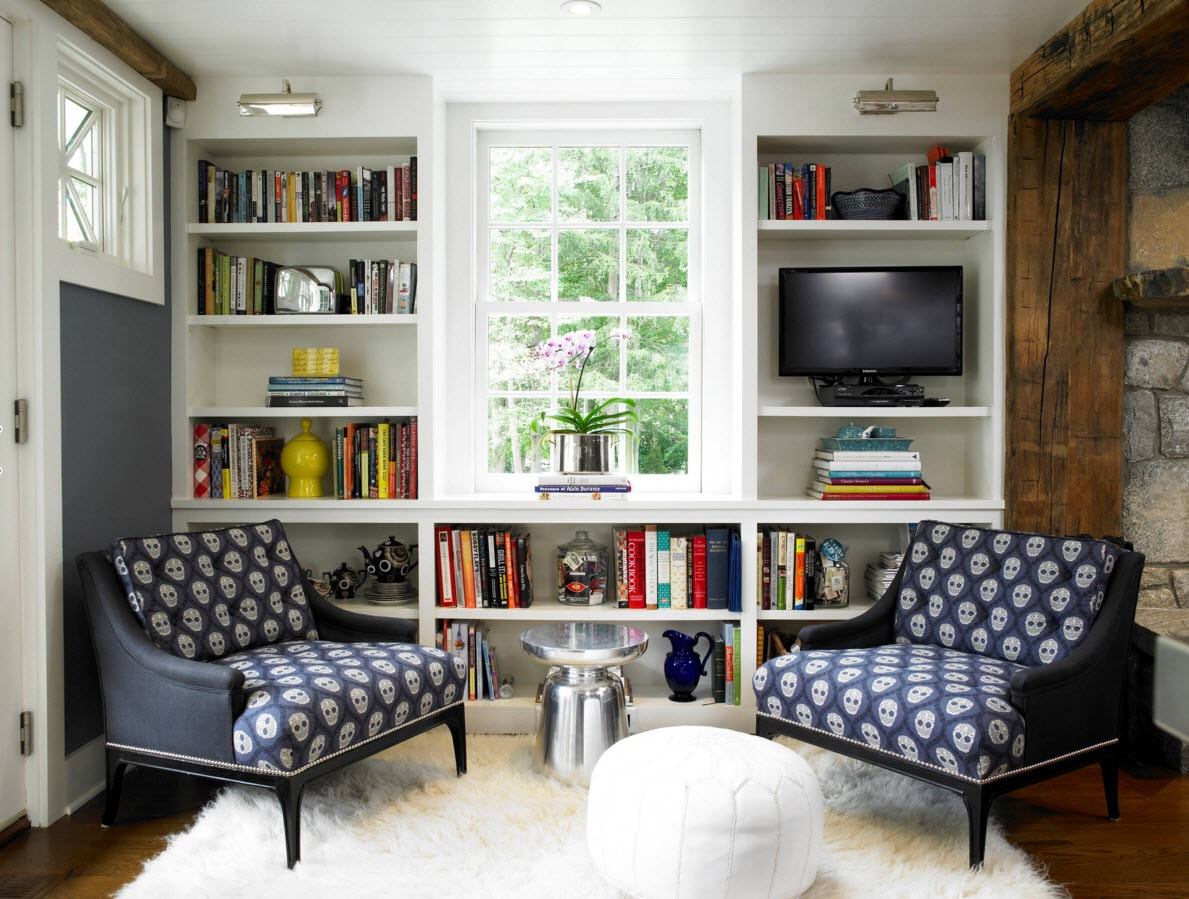 Storage Systems Variety for the Living Room. Nice pattern of the armchairs at the foreground and the latticed windows with the open shelves at the background