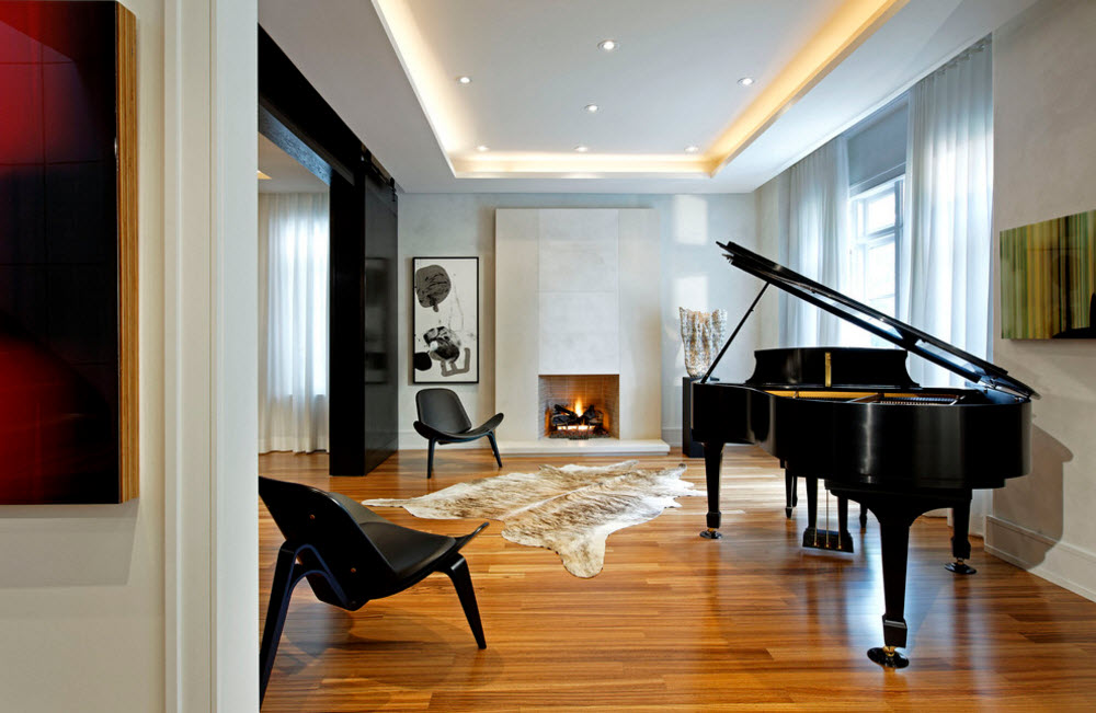 Exclusive Two-Storey House Design. Black grand piano in the highlight of the spacious living room with perimeter backlight
